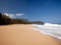Waves over beach on Lumahai Stock Image