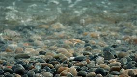 Waves Over Beach Pebbles stock video footage