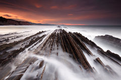 Waves over the flysch at sunset Stock Image