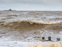 Waves over groynes in Herne Bay, Kent, UK Royalty Free Stock Photo