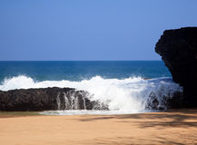 Waves over rocks on Lumahai Stock Image