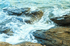 Waves over rocky coast Stock Images