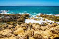 Waves of the Pacific Ocean crashing onto the rocky shoreline of the west coast of the island of Oahu. At the resort area of Ko Olina, in the island state of Stock Photos