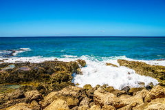 Waves of the Pacific Ocean crashing onto the rocky shoreline of the west coast of the island of Oahu. At the resort area of Ko Olina, in the island state of Royalty Free Stock Photo