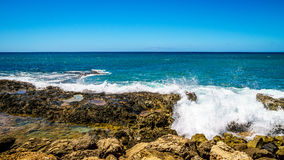 Waves of the Pacific Ocean crashing on the rocks on the shoreline of Ko Olina. On the island of Oahu in the island state of Hawaii Stock Image