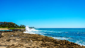 Waves of the Pacific Ocean crashing on the rocks on the shoreline of Ko Olina. On the island of Oahu, in the island state of Hawaii Royalty Free Stock Photo
