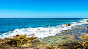 Waves of the Pacific Ocean crashing on the rocks on the shoreline of Ko Olina on the island of Oahu. In the island state of Hawaii Royalty Free Stock Photo