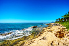 Waves of the Pacific Ocean crashing on the rocks on the shoreline of Ko Olina on the island of Oahu Stock Photo