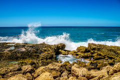 Waves of the Pacific Ocean crashing on the rocks on the shoreline of Ko Olina on the island of Oahu. In the island state of Hawaii Royalty Free Stock Photos