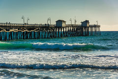 Waves in the Pacific Ocean and the fishing pier   Stock Photo