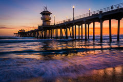 Waves in the Pacific Ocean and the pier at sunset  Royalty Free Stock Images