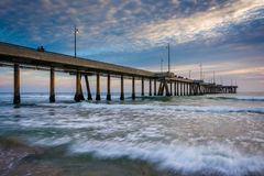 Waves in the Pacific Ocean and the pier at sunset  Stock Photography