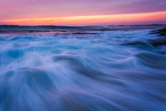 Waves in the Pacific Ocean at sunset  Stock Photography