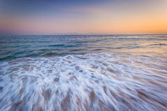 Waves in the Pacific Ocean at sunset, in Santa Barbara, Californ Stock Photos