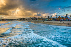 Waves in the Pacific Ocean and view of the beach at sunset. Waves in the Pacific Ocean and view of the beach at sunset, in Newport Beach, Californi Royalty Free Stock Photos