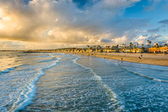 Waves in the Pacific Ocean and view of the beach at sunset. Waves in the Pacific Ocean and view of the beach at sunset, in Newport Beach, Californi Stock Images