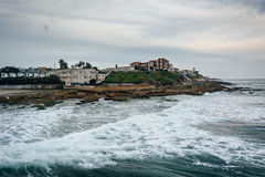 Waves in the Pacific Ocean. And view of buildings on the coast in Ocean Beach, California stock image