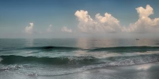 Waves. Panoramic view of waves breaking on shore royalty free stock photography