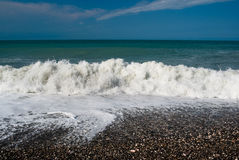Waves on the pebble beach of the Black Sea Royalty Free Stock Images