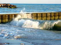 Waves at the pier. In the evening sun Royalty Free Stock Photography