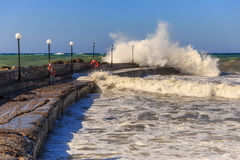 Waves at a pier. At Creta hotel beach near chersonisos royalty free stock images
