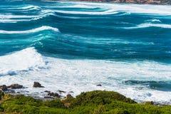 Waves in Porto Ferro blue sea Royalty Free Stock Photos
