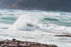 Waves in Porto Ferro shore Stock Photo