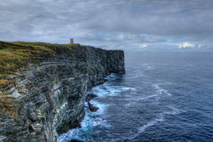 Waves pound the shore at Marwick Head in Orkney, Scotland Royalty Free Stock Photos