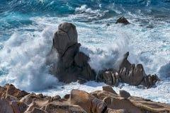 Waves pounding the coastline at Capo Testa Sardinia Stock Images