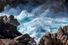 Waves pounding the coastline at Capo Testa Sardinia Royalty Free Stock Images