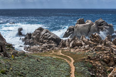 Waves Pounding the Coastline at Capo Testa Sardinia Stock Image