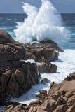 Waves pounding the coastline at Capo Testa Sardinia Stock Photos