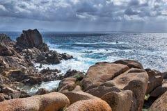Waves Pounding the Coastline at Capo Testa Sardinia Royalty Free Stock Photography
