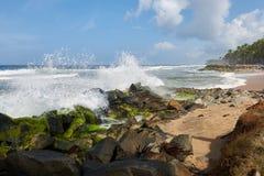 Waves pounding a rock strewn beach Stock Image
