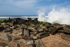 Waves pounding rocks on a beach Royalty Free Stock Photo