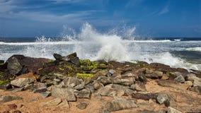 Waves pounding rocks on a beach Stock Image