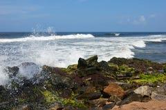 Waves pounding rocks on a beach Stock Photos