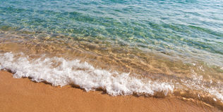 Waves on red sand beach, Corsica, France Stock Photo