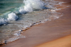 Waves  Retreating on Sandy Beach Royalty Free Stock Photos