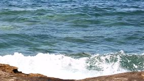 Rock in the sea. Waves and rock on the sea closeup stock video