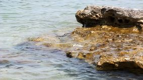 Rock in the sea. Waves and rock on the sea closeup stock video footage