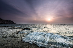 Waves, rock and sun Royalty Free Stock Photo