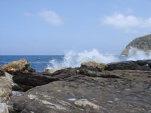 Waves on the rocks. Looking the waves braking on the rocks royalty free stock photo