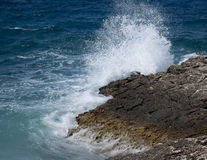 Waves on the rocks Stock Photos