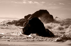 Waves on Rocks. Waves crashing around rocks, toned in Sepia Stock Photography