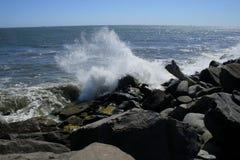 Waves and Rocks. Ocean waves crashing in the rocks of the jetty near Ocean Shores Washington Royalty Free Stock Photos