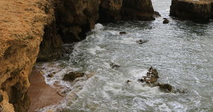 Waves and rocks in the Algarve, Portugal stock footage