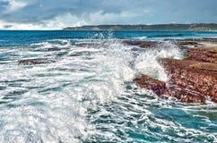 Waves on rocks at the coast Stock Image