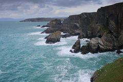 Waves and rocks on the coast of ireland. Waves and rocks along the coast of south western ireland at Mizen Head. Wind causes strong waves in the ocean stock photos
