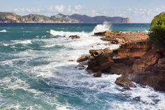 Waves on the rocks. At the coast of Mallorca and view on Cap de Formentor Royalty Free Stock Photography
